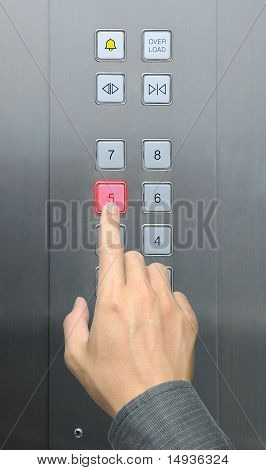 businessman hand press 5 floor in elevator