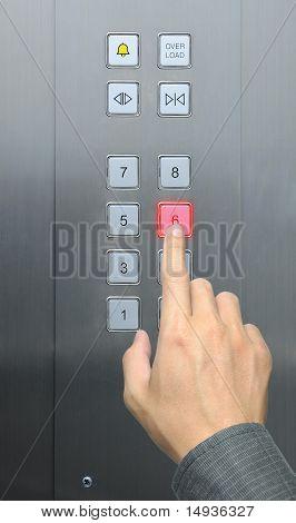 businessman hand press 6 floor in elevator