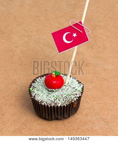 Flag of turkey . Apple Cupcake with red apple shape bonbon on the top