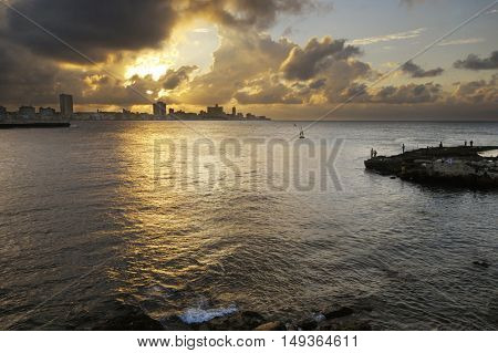 Havana bay entrance and city skyline at sunset with big clouds
