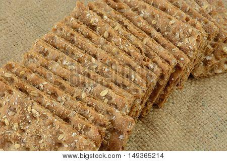 Multi grain whole grain crispbread crackers on burlap