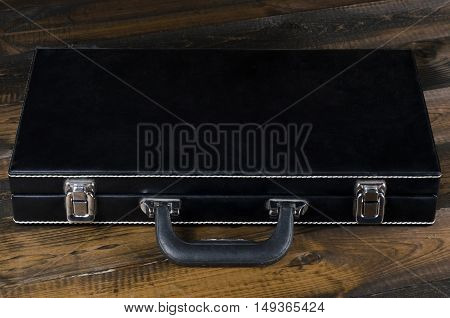 leather poker chip case on a wooden background