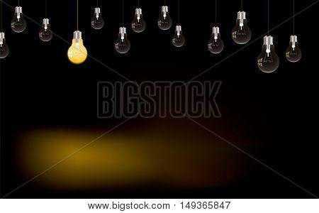 Single lone light bulb lit in darkness