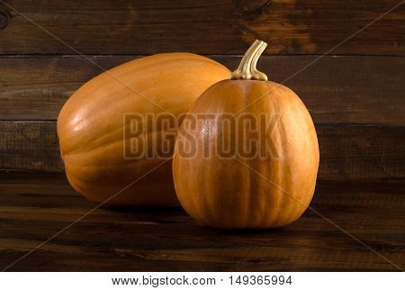 autumn background with pumpkin on a wooden board