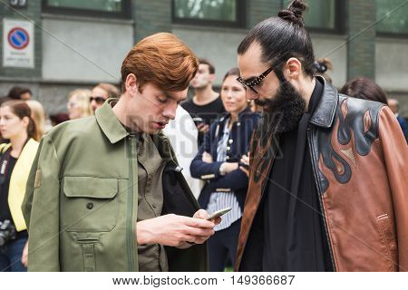 Fashionable Men Posing During Milan Fashion Week