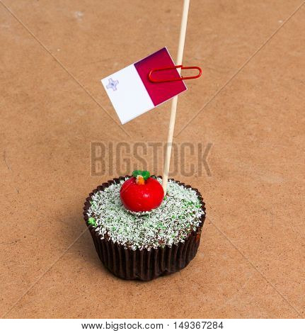 Flag of Malta. Apple Cupcake with red apple shape bonbon on the top