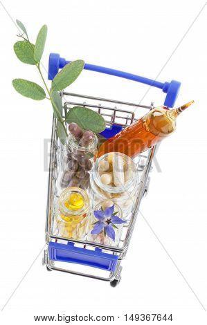 Shopping cart full of pharmaceutical drug and medicine pills on white background
