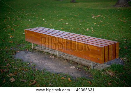 Wooden bench in the park closeup photo