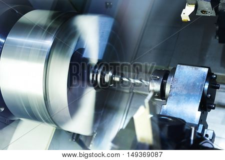Cutters for metal and drill set the CNC machine tool magazine. Metal shavings.