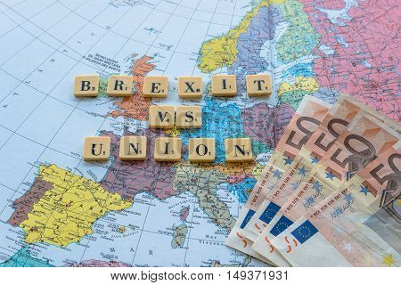 London UK - June 12 2016: Brexit vs Union words on european map with euro money. The United Kingdom European Union membership referendum on 23 June 2016