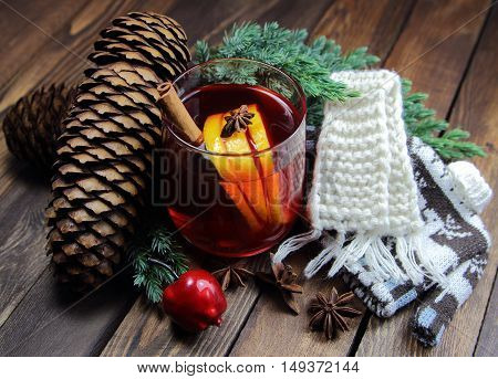 mulled wine with a lemon, cinnamon and a knitted scarf with a jumper
