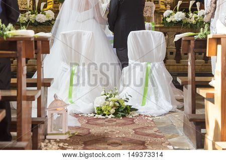 married couple in front of the church altar
