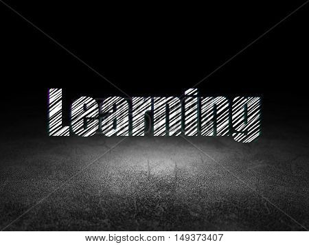 Learning concept: Glowing text Learning in grunge dark room with Dirty Floor, black background