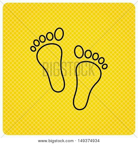 Baby footprints icon. Child feet sign. Newborn steps symbol. Linear icon on orange background. Vector