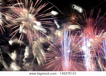 colorful fireworks in the night sky bright spark in the fog