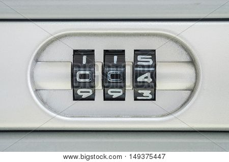 Closeup code number for lock the old suitcase background with 004 password