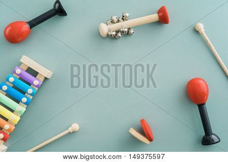 Collection of musical instruments with copyspace on turquoise