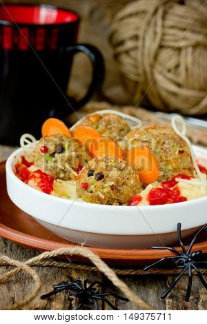Halloween dinner idea for kids baked bloody rats in potatoes with bloody tomato sauce