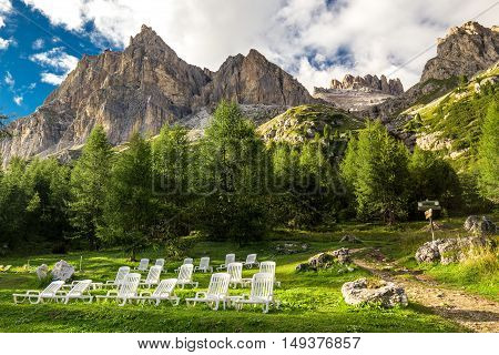 Magnificent valley with Cristallo mountain group near Cortina d'Ampezzo with relaxing chairs in foreground Dolomites mountains Italy Europe