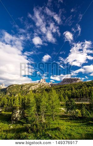 View to Dolomites mountains from Pordoi Pass mountain road Italy Europe