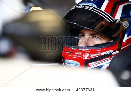 Sparta, KY - Sep 23, 2016: Darrell Wallace Jr (6) straps into his car to practice for the VisitMyrtleBeach.com 300 at the Kentucky Speedway in Sparta, KY.