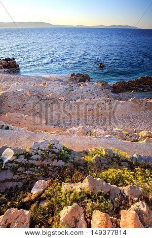 Sunrise over the rocky beach on the coast of Adriatic Sea Istria Croatia