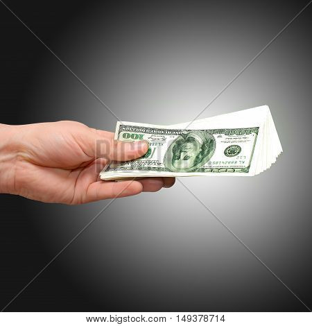 Money 100 dollars usa in hand. give the money to pay