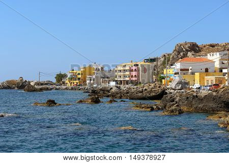 Houses at rocky coastline of Paleochora town on Crete island, Greece