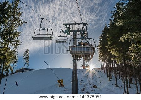 The rise in the chair lift to the top of the mountain. Bukovel Ukraine.