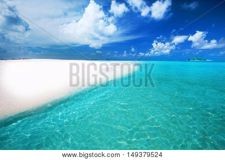 Tropical Island With Sandy Beach With Palm Trees And Turquoise Clear Water
