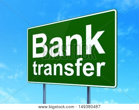 Money concept: Bank Transfer on green road highway sign, clear blue sky background, 3D rendering