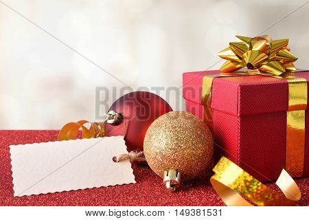 Xmas Decoration On Red Table And White Background