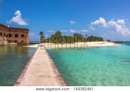 The tropical waters of the Gulf of Mexico surround Historic Fort Jefferson in the Dry Tortugas National Park known for its famous bird, marine life and great place for swimming and snorkeling.