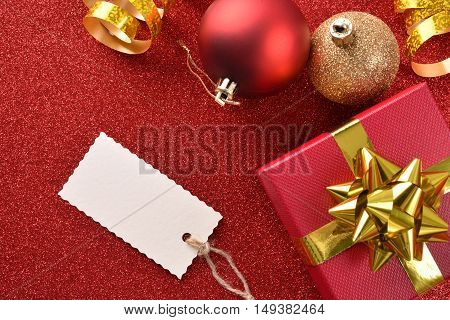 Xmas Decoration With Tag Gift Balls On Red Table Top