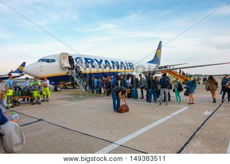 Bratislava, Slovakia - September 19. 2016: Passengers boarding on the aircraft of low cost airline company Ryanair