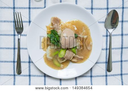 Rad Na, Famous Thai Chinese Style Wide Rice Noodle Dish With Tasty Tender Pork With Thick Gravy Sauc