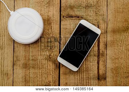 White Smartphone And Charging Pad.