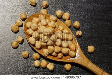 Hazelnuts on a wooden spoon. Roasted twice.