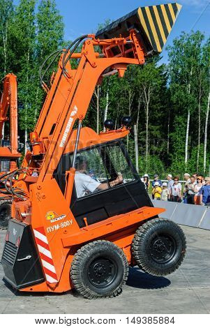 Nizhniy Tagil, Russia - July 12. 2008: RAE-2008 exhibition. Show program of skid loader