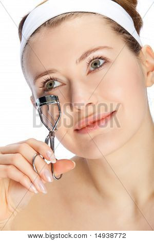Young Woman Cutting Eye Lashes