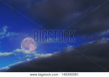 Background for design of the full moon of black clouds and light.