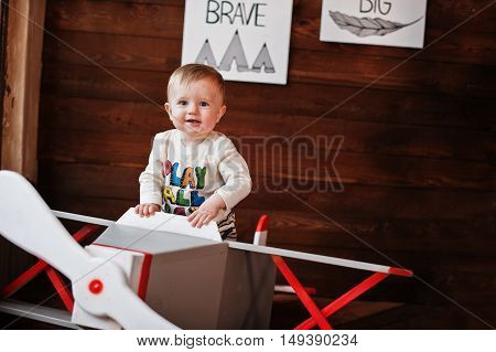 Young Caucasian Baby Boy On Decor Plane Having Fun