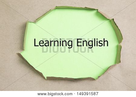 Learning English written under torn paper, old torn paper
