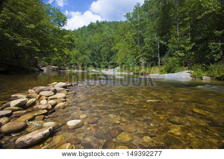 Boulders and water on Wilson Creek in North Carolina in August