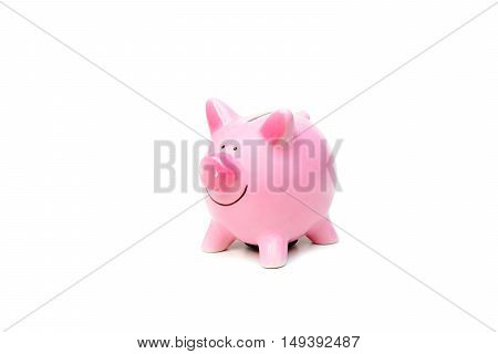 A pink piggybank isolated on white background