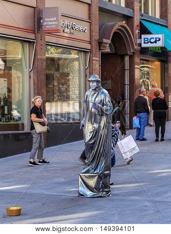 Geneva, Switzerland - 24 September, 2016: a costumed person asking for money on a downtown street. Geneva is the second most populous city in Switzerland after Zurich and is the most populous city of the French-speaking part of Switzerland.