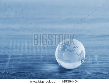 World glass sphere with continents on the table