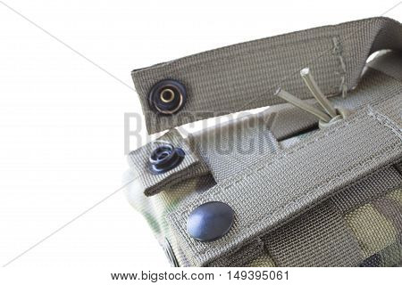 Clips that are used to attach an AR-15 magazine pouch to webbing