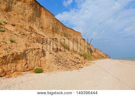 hill on the coastline is destroyed by landslide