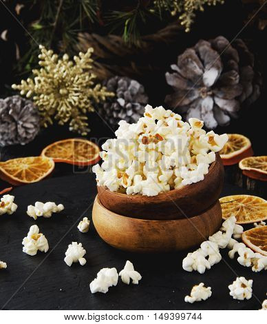 Popcorn In A Wooden Plate On The Background Of Christmas